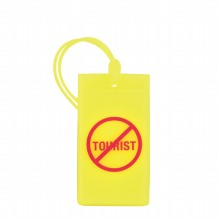 <<F1 Icon Rubber Tag Not a Tourist>> ラゲージタグ スーツケースタグ イエロー / 50102-13